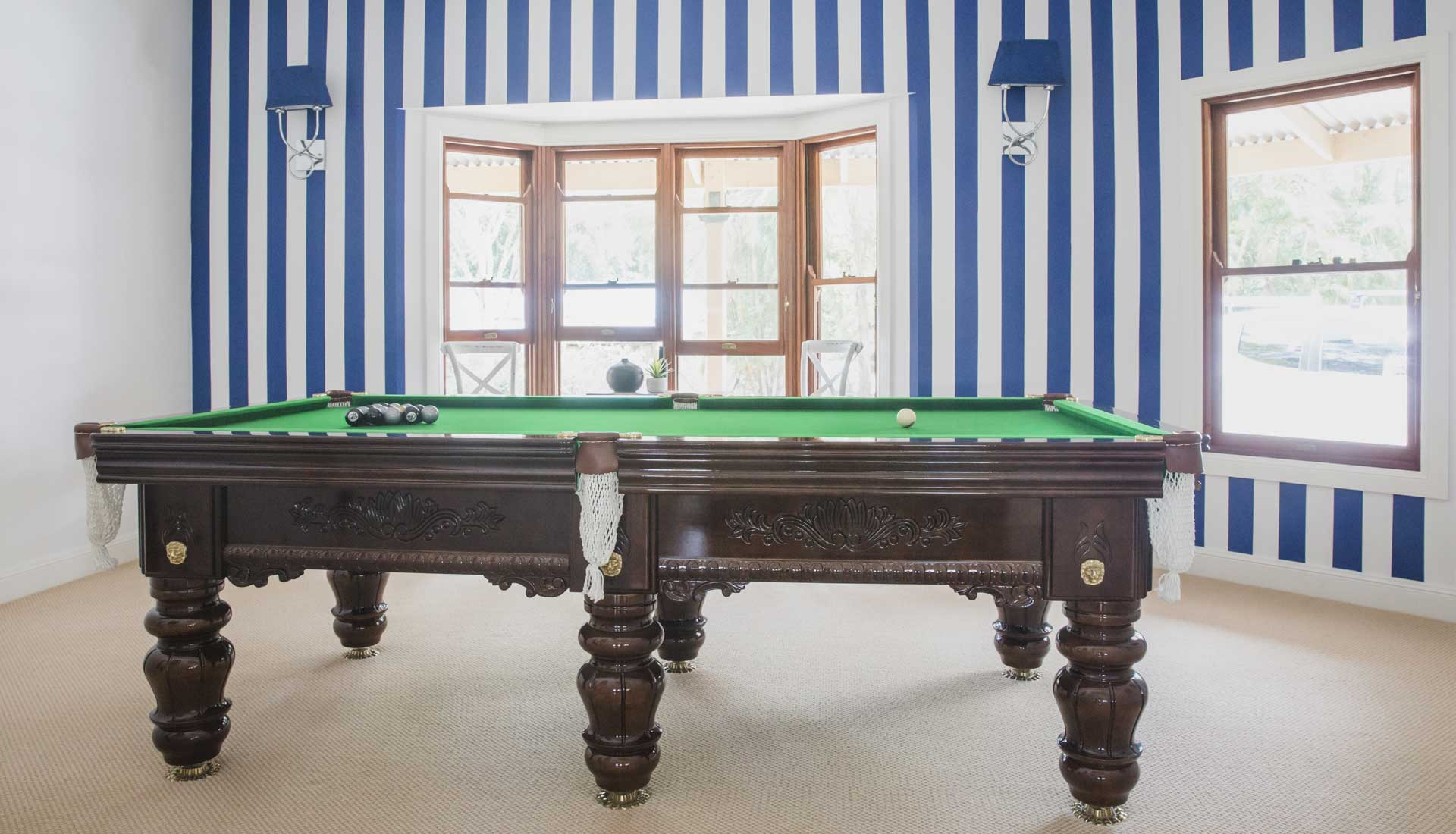 pool room blue and white wall stripes design by danni