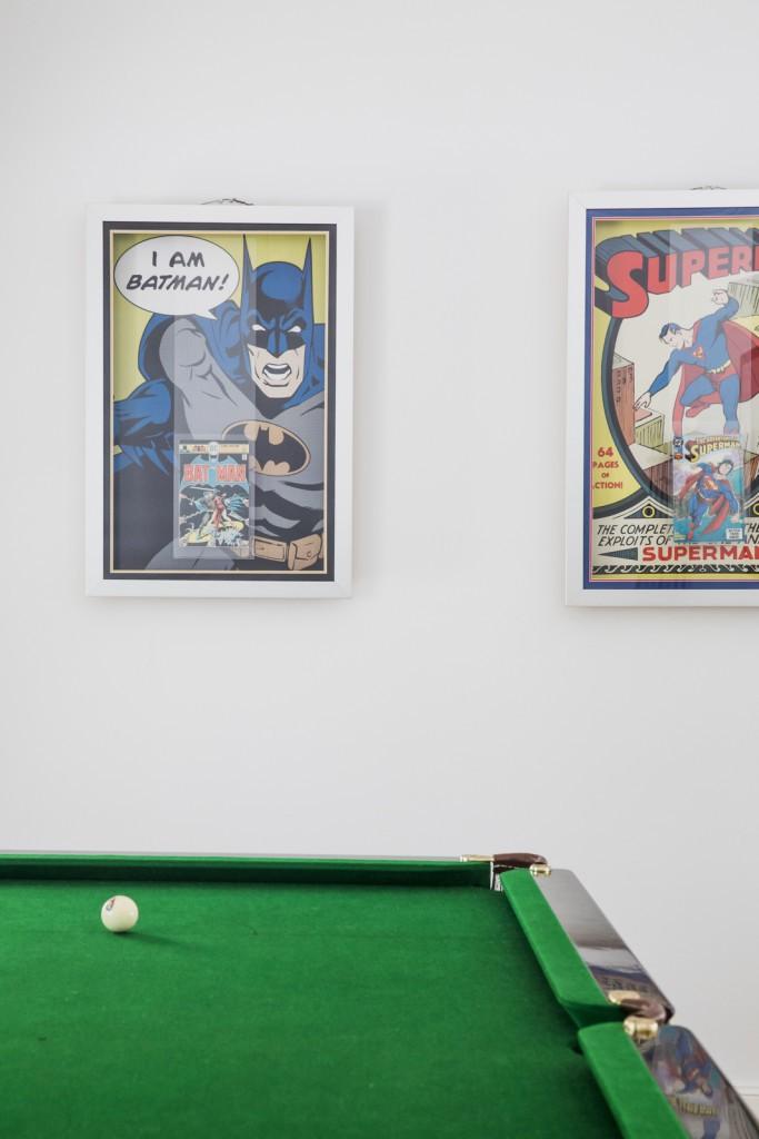 our framed batman and superman comics