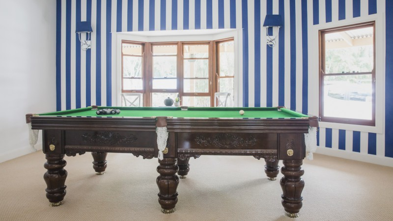 blue and white painted wall stripes in pool room