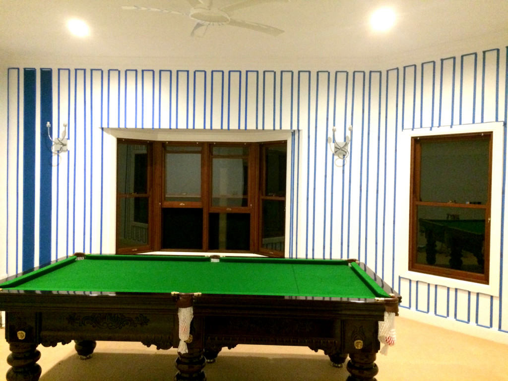 pool room wall taped up before painting
