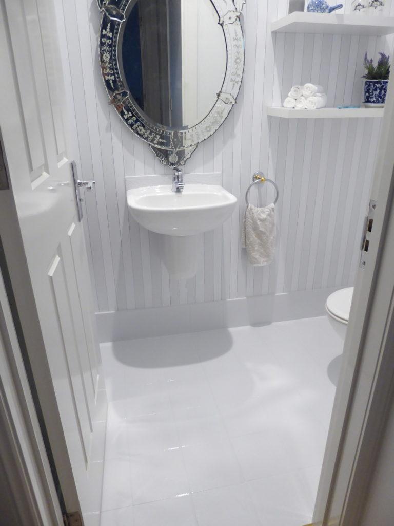 kids toilet wall stripe and floor tile detailafter renovation