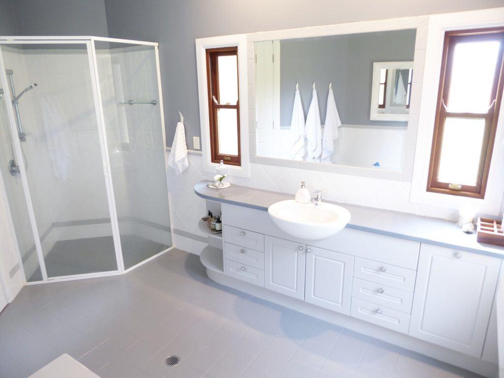 kids bathroom makeover completed cabinetry, floor tile and shower detail