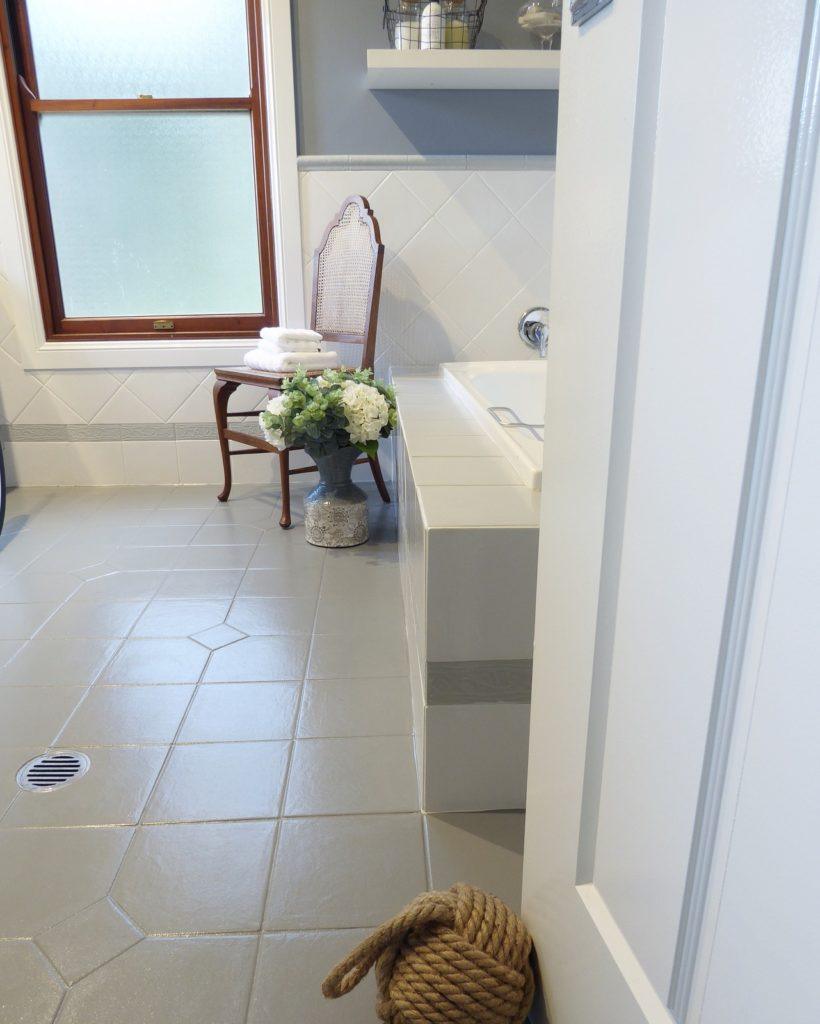kids bathroom makeover completed floor tile and anitque chair