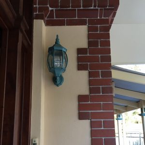 exterior front door, brick render and lighting detail original