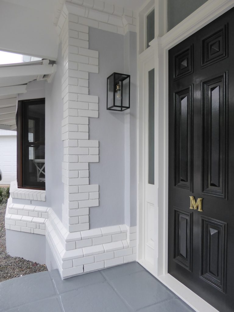 completed front of exterior entry brick, render and window detail