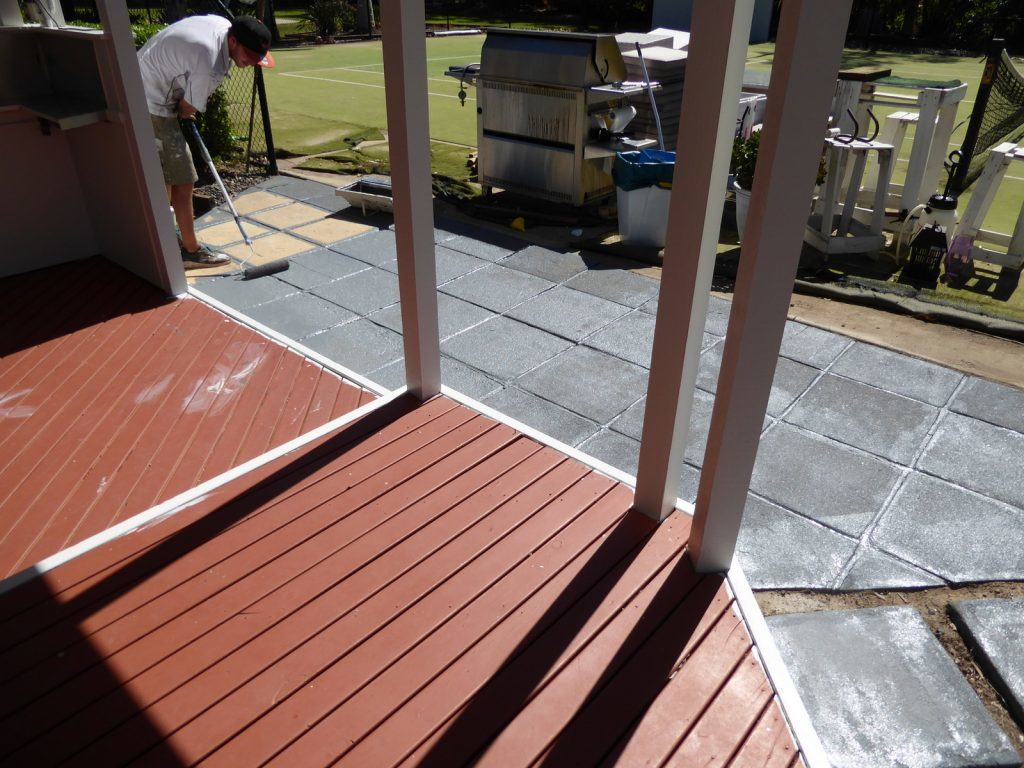 painting the remaining pavers next to the gazebo