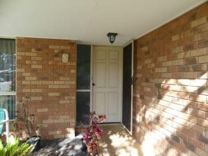 front exterior and front door before renovation tewantin