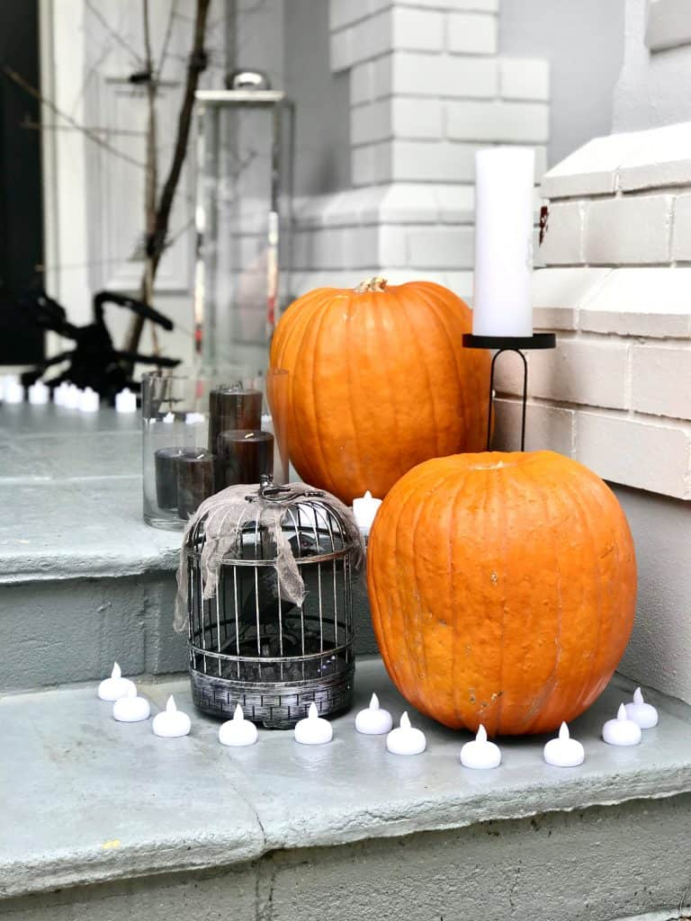 halloween styling - pumpkin, crow and candle vignette